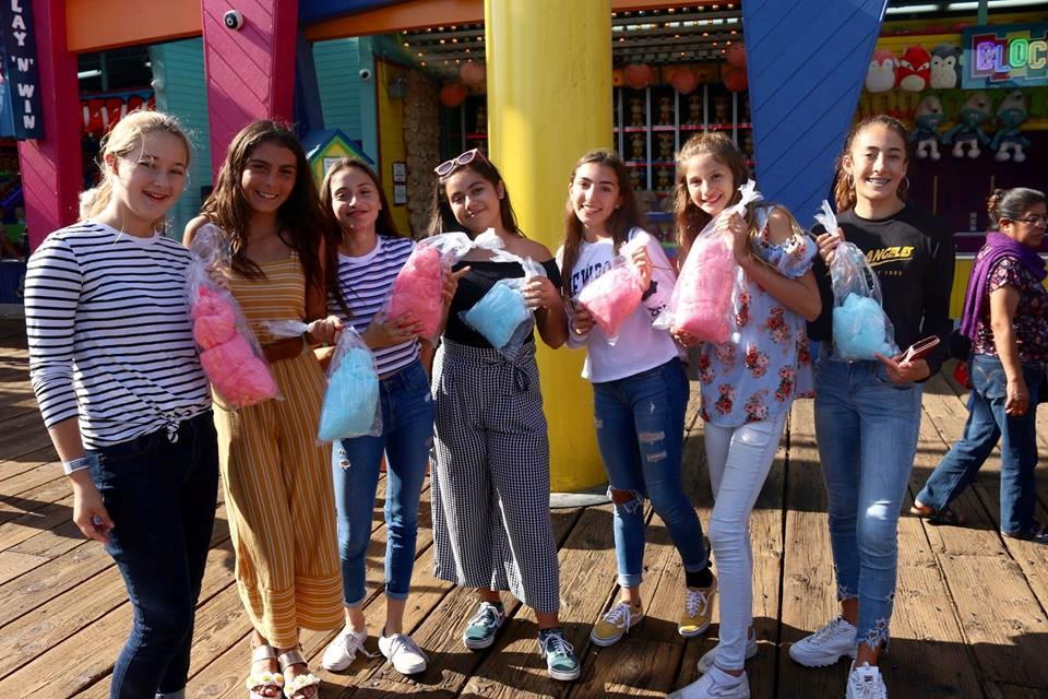 Group enjoying cotton candy on the Santa Monica Pier