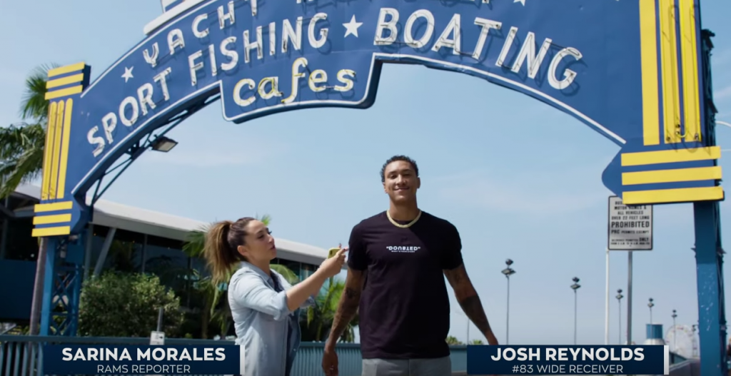 Josh Reynolds in front of Santa Monica Pier sign