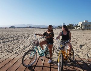 Two women with bikes on the Santa Monica boardwalk