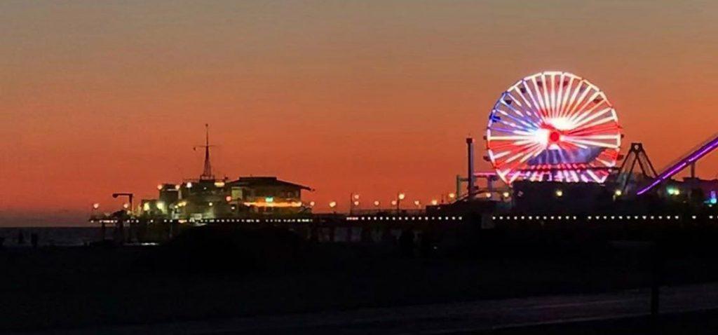 The American flag displayed on the Santa Monica Pier Ferris Wheel - photo by @twocrazytraveldudes