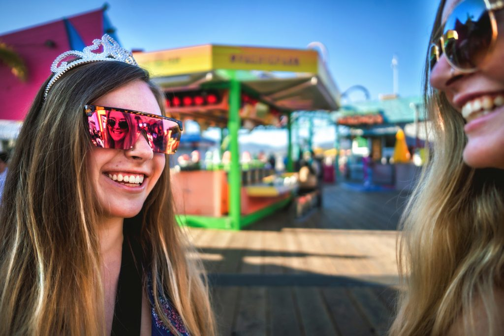 Girls smiling in sunglasses inside Pacific Park