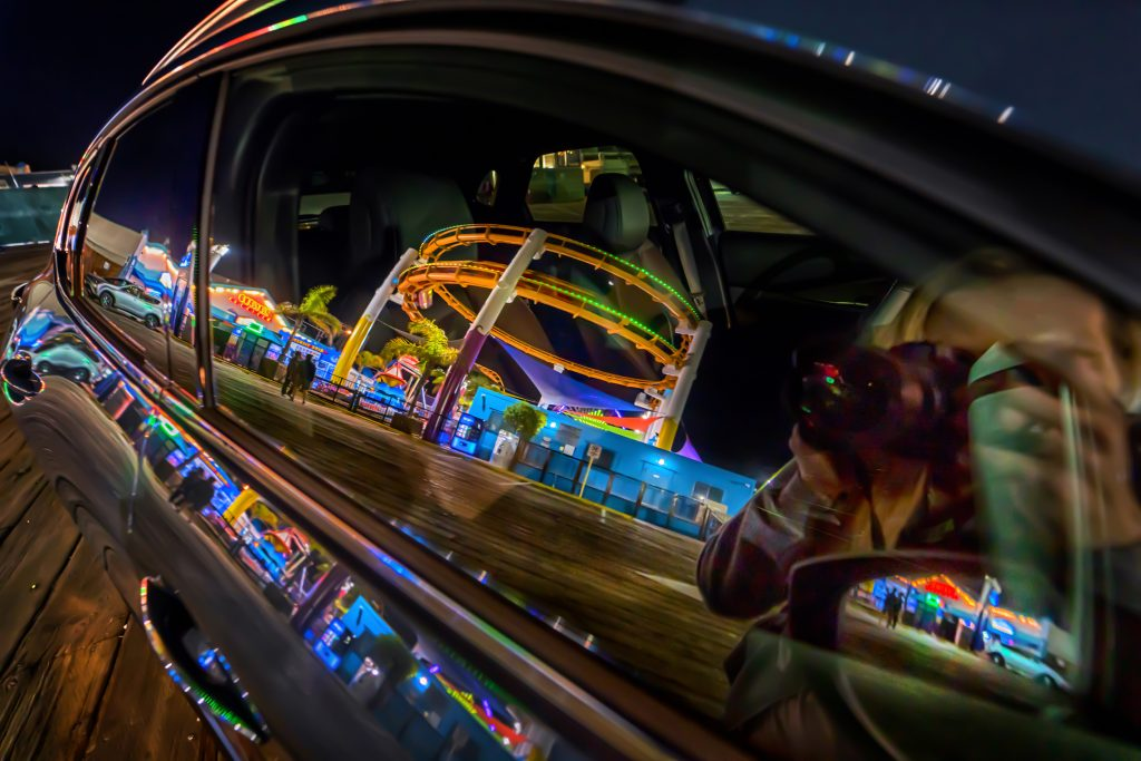 Reflection of rollercoaster in car window