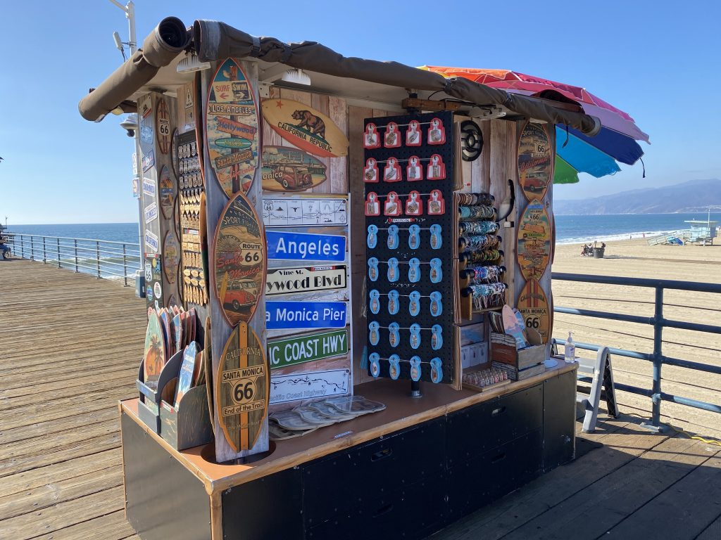 Pier Photo Cart selling decorative signs on the Santa Monica Pier