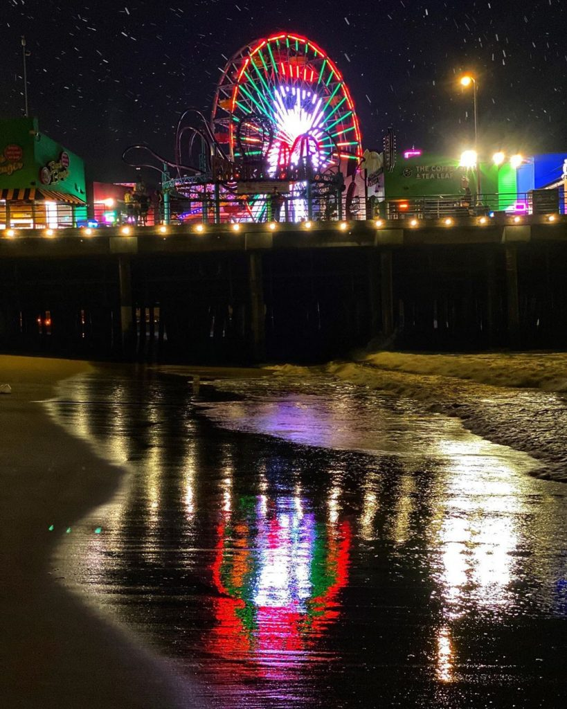 The Santa Monica Pier celebrates the holidays with an 80-foot tall snowman animated on the Pacific Wheel at Pacific Park.