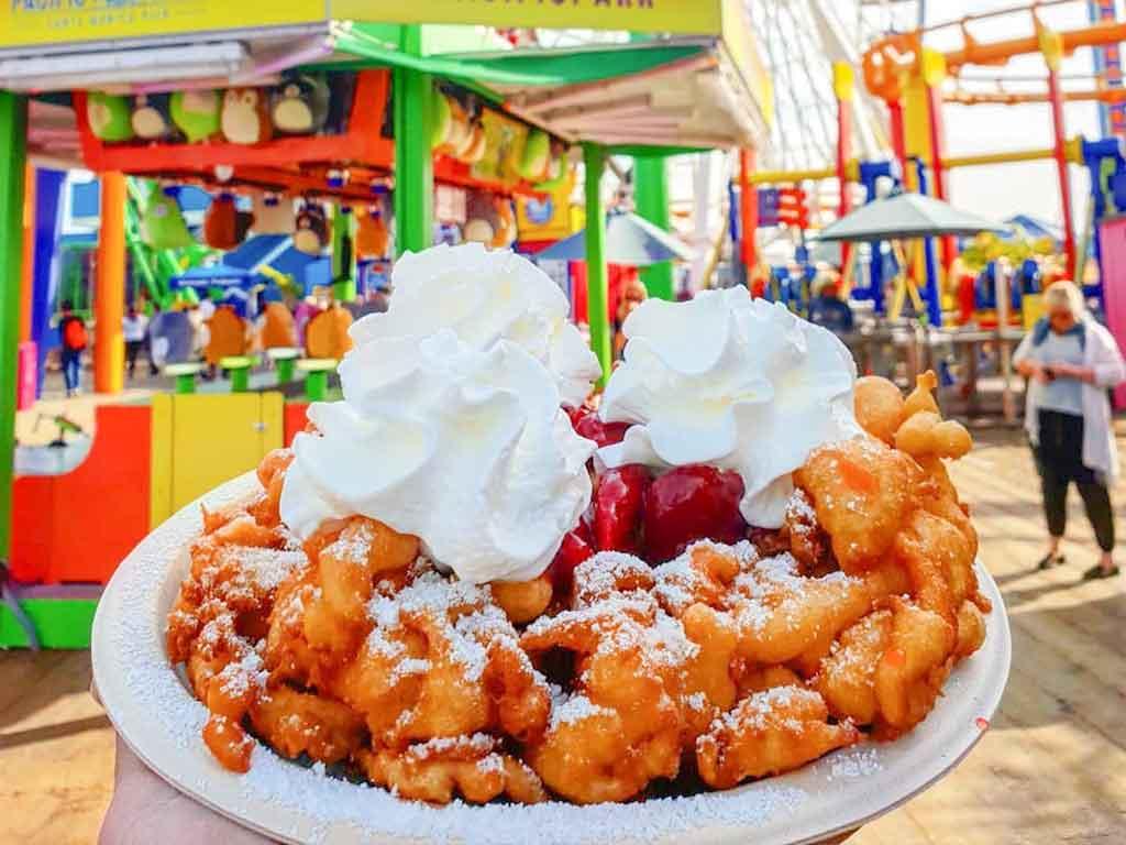 Funnel Cake in front of the Santa Monica Pier Ferris wheel