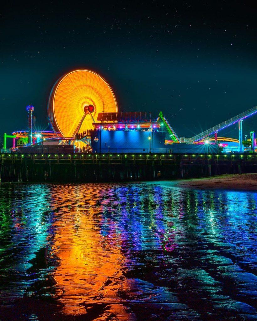 The Santa Monica Pier Ferris Wheel lit Amber for Covid Memorial Photo by @aayuskhjain.jpg
