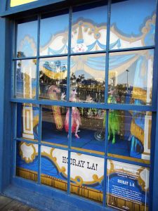 Window with marionettes on display