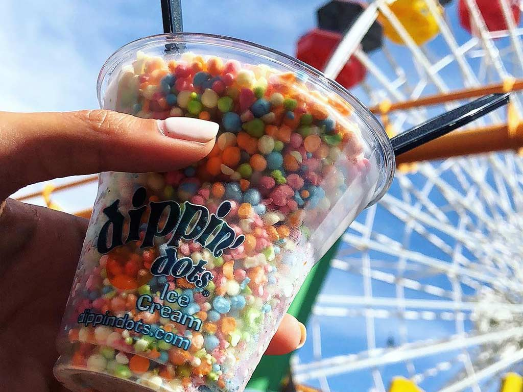Hand holding cup of Dippin' Dots