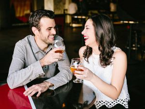 Couple holding beer