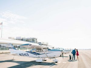 Couple in front of airplane at Santa Monica Airport