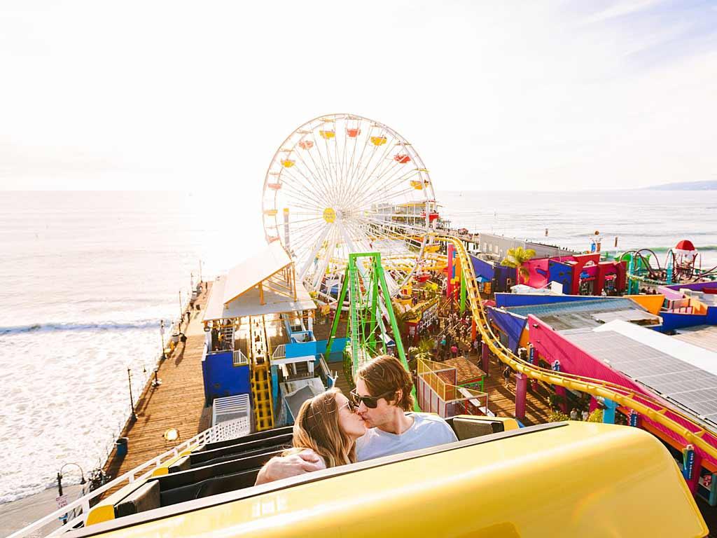 Couple on Santa Monica Pier roller coaster