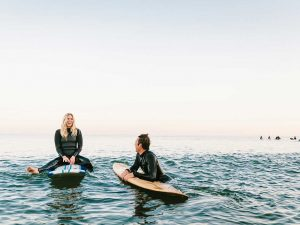 Couple on surfboards in water