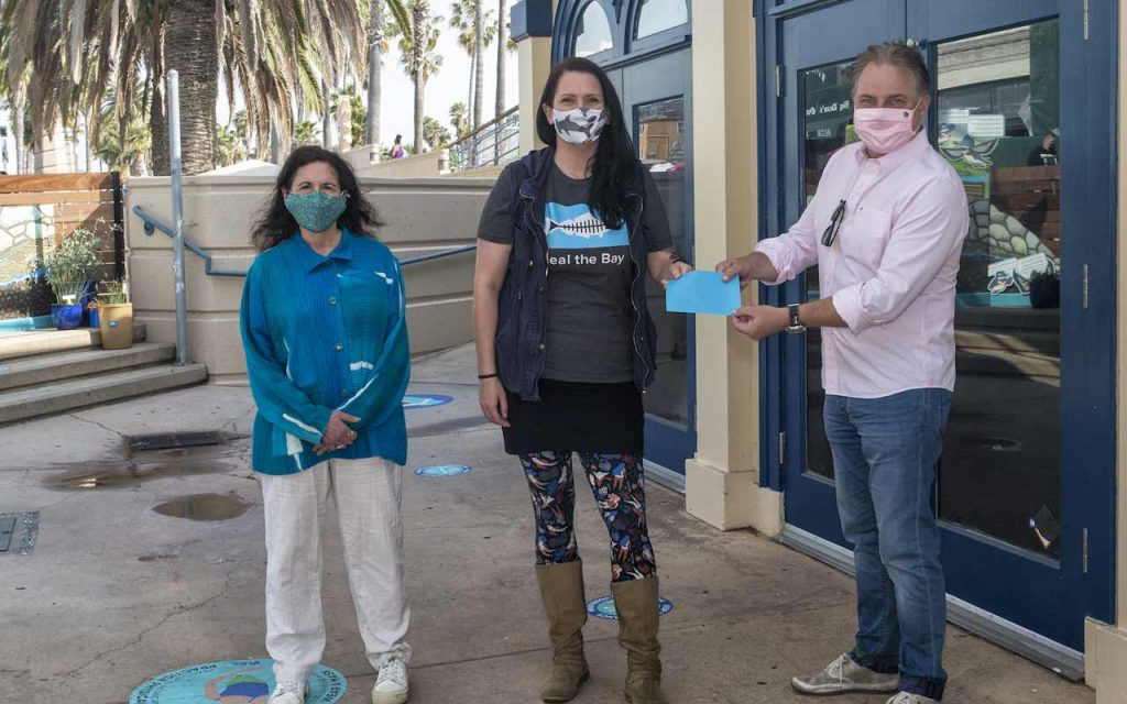 Santa MoniCARES check presentation to Heal the Bay