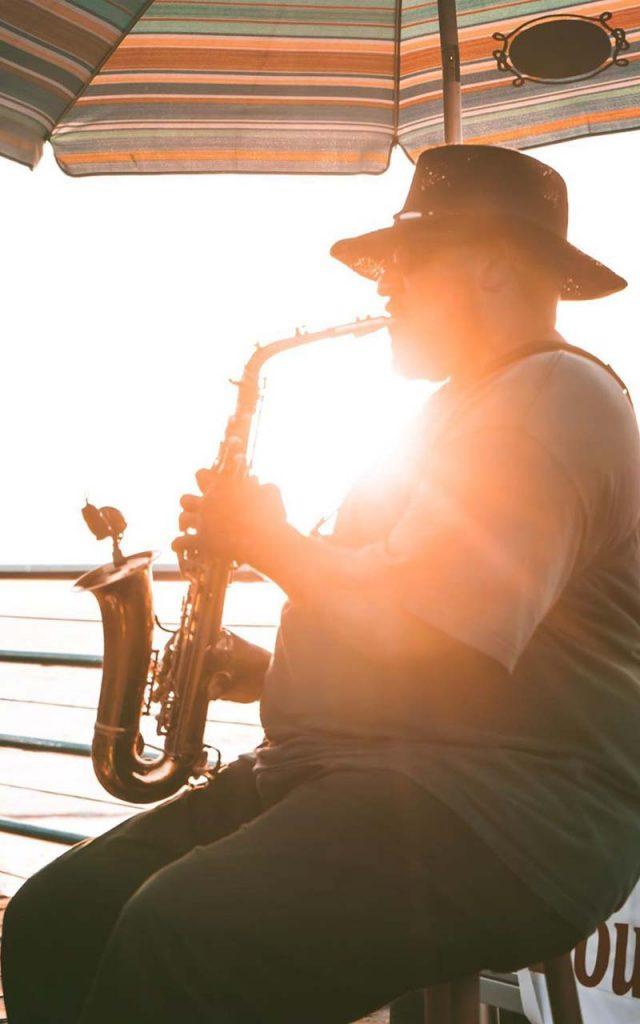 Man playing saxophone on the Santa Monica Pier